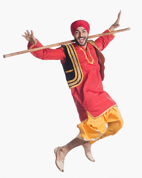 Man doing Bhangra the folk dance of Punjab in India
