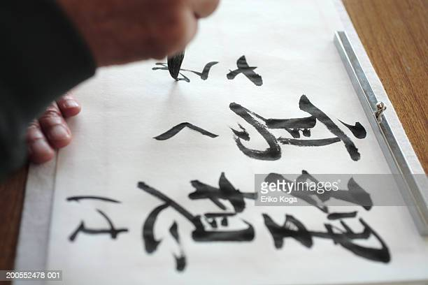 Man doing calligraphy, elevated view