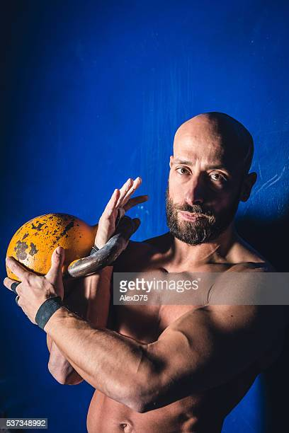 Man doing cross fitness workout with kettlebell