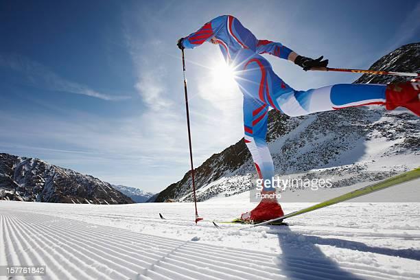 man doing cross-country skiing competition - deporte de invierno fotografías e imágenes de stock