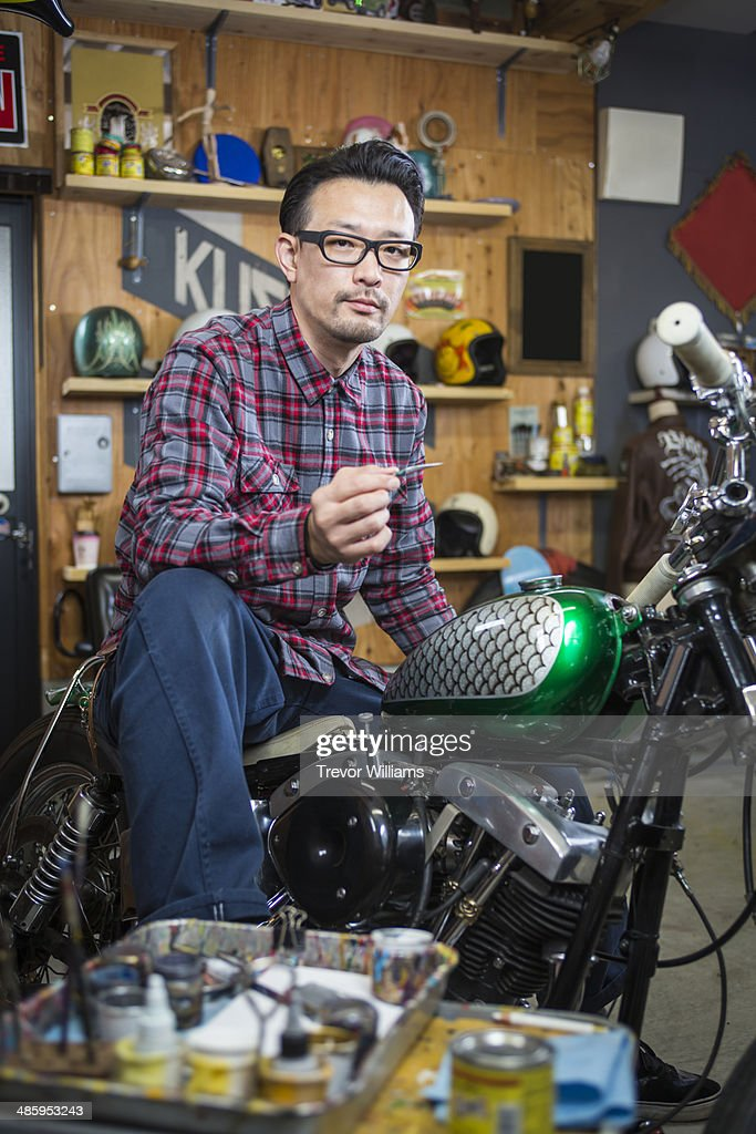 A Man Doing Custom Paint On A Motorcycle Gas Tank Stock Photo