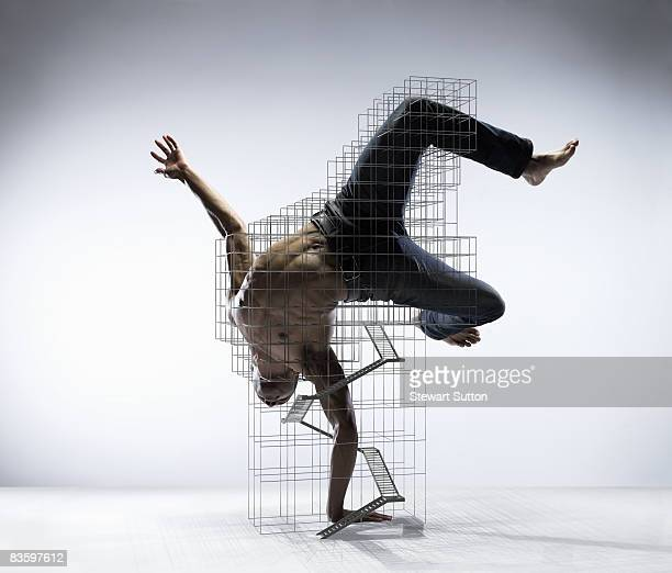 man doing dance move supported by armature