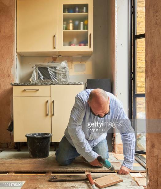 man doing diy at home - renovation stock pictures, royalty-free photos & images