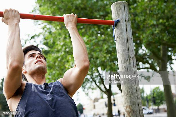man doing exercise in park - muscular build stock pictures, royalty-free photos & images