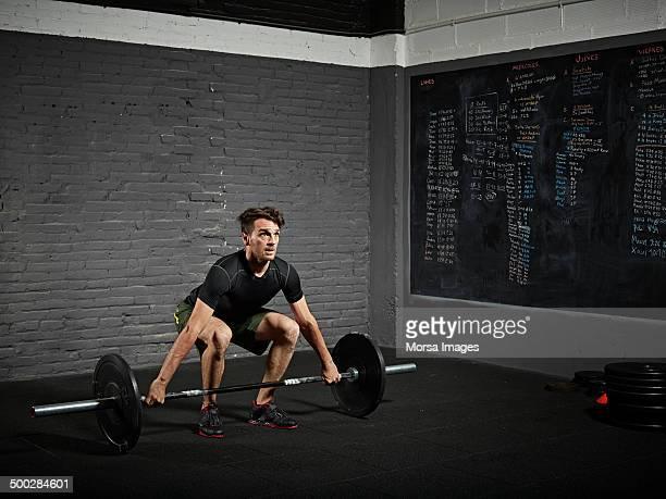 Man doing gym/snatch