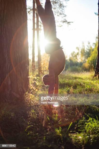 Man doing handstand in park