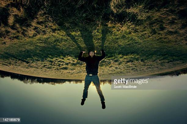 man doing headstand - scott macbride stock pictures, royalty-free photos & images