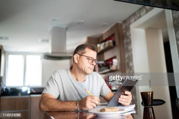 man doing home office - reading glasses stock pictures, royalty-free photos & images