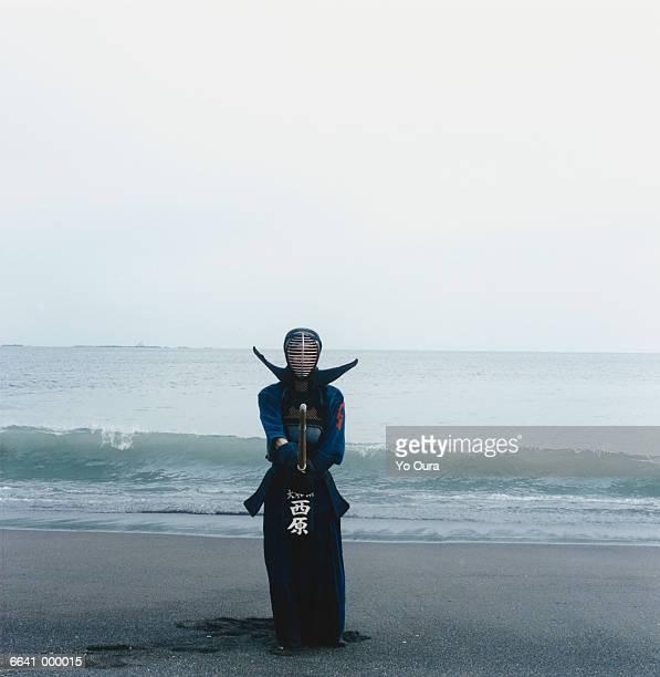 Man Doing Kendo on Beach