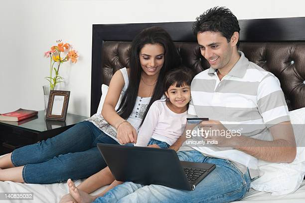 Man doing online shopping with his family