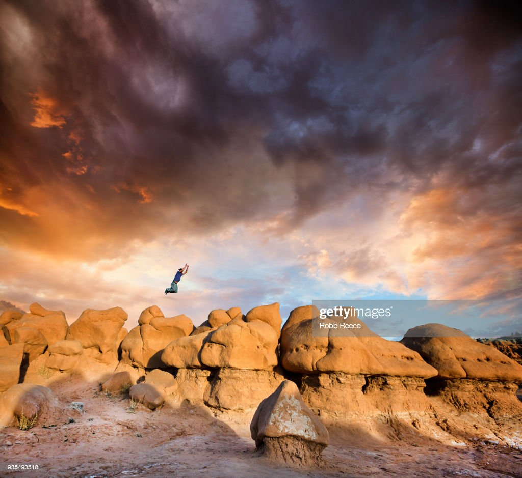 A man doing Parkour on rocks in the desert : Stock Photo
