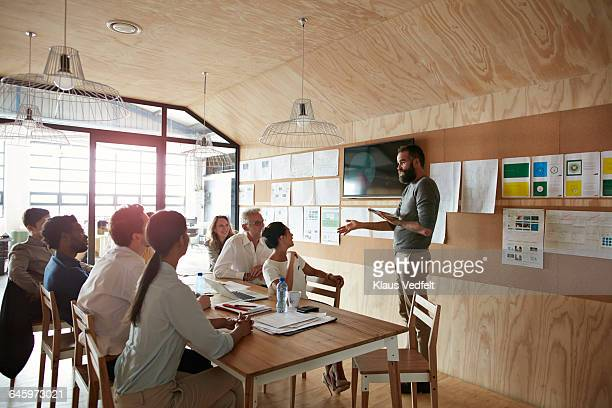 Man doing presentation in modern meeting room
