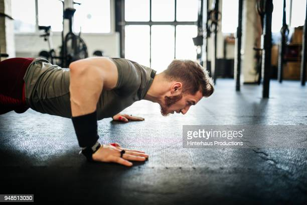 man doing push ups at gym - push ups stock pictures, royalty-free photos & images