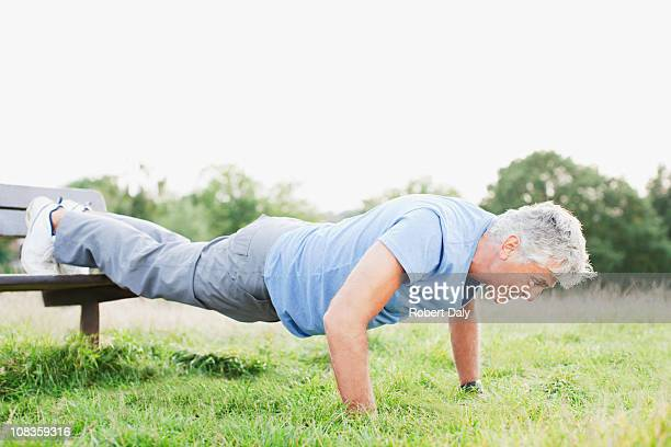 Man doing push-ups in field