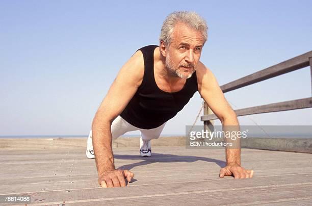 Man doing push-ups on dock