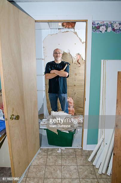 Man doing renovation in wardrobe or closet