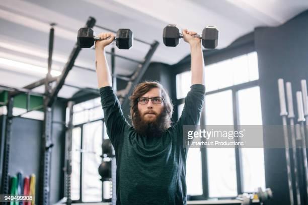 man doing  routine at gym - routine stockfoto's en -beelden