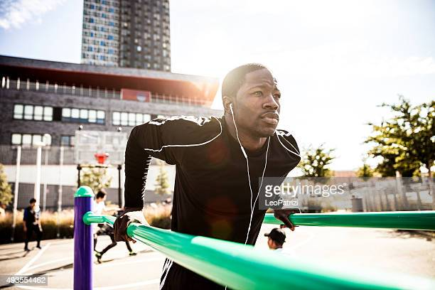 Man doing shoulder exercises in New York City