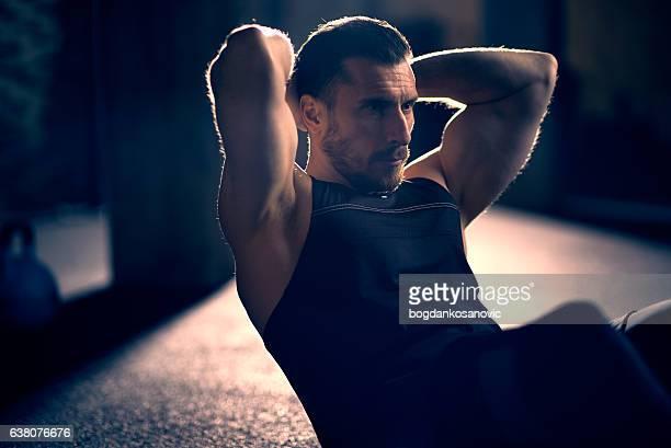 man doing sit-ups - dansstudio stock pictures, royalty-free photos & images