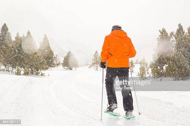Man doing snowshoeing on the Andorra Pyrenees