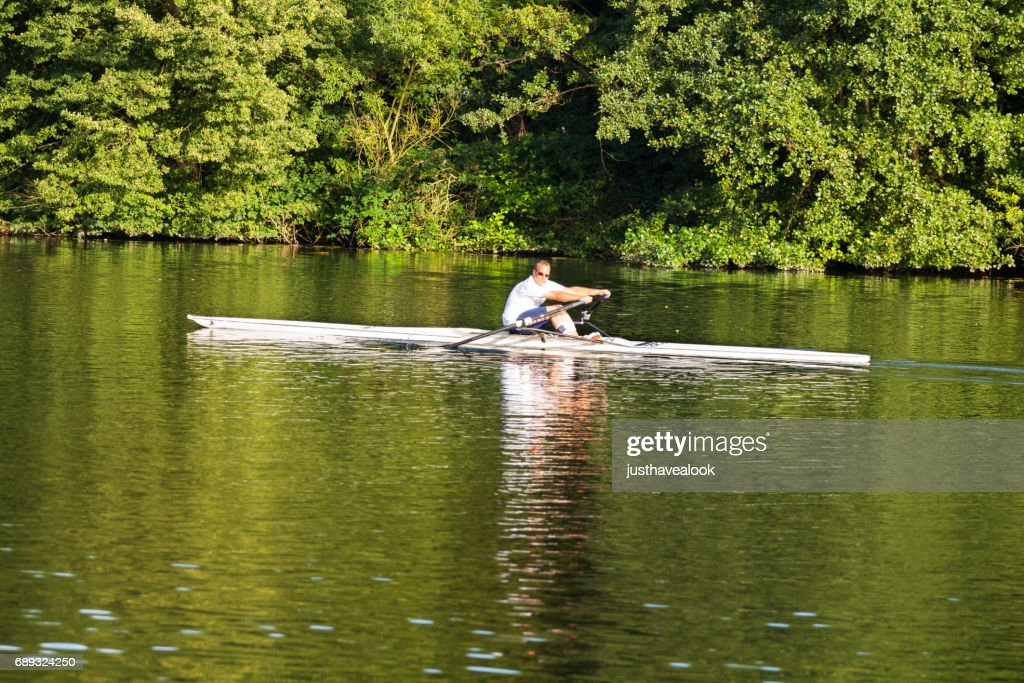 Man doing sport rowing on Ruhr : Stock Photo