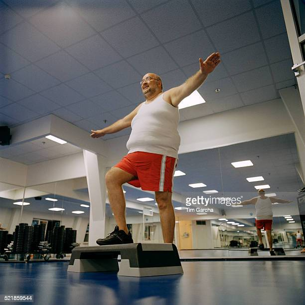 Man Doing Step Exercises in Gym