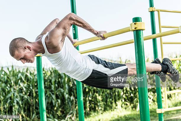Man doing street workout exercise