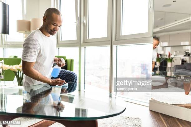 man doing the chores and cleaning house