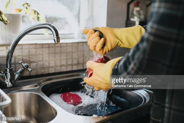 man doing the dishes - hand stock pictures, royalty-free photos & images