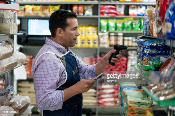 Man doing the inventory while working at a supermarket