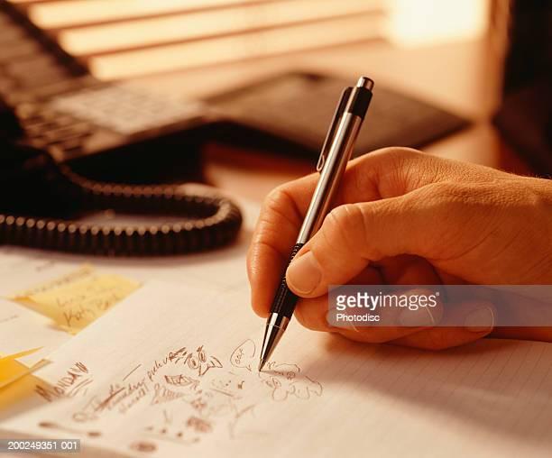 Man doodling, (Close-up)