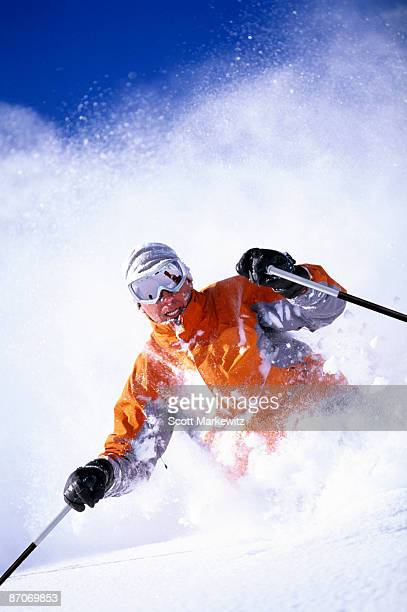 Man downhill skiing in Utah on a sunny day.