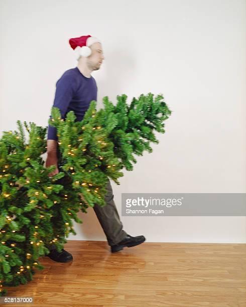 Man Dragging Away Christmas Tree