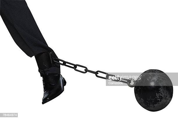 Man dragging ball and chain