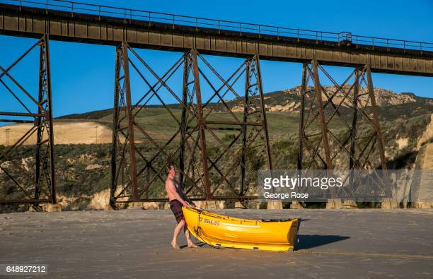 A man drags his small fishing boat onto the sand at Gaviota Beach on December 28 in Gaviota State Park California Because of its close proximity to...