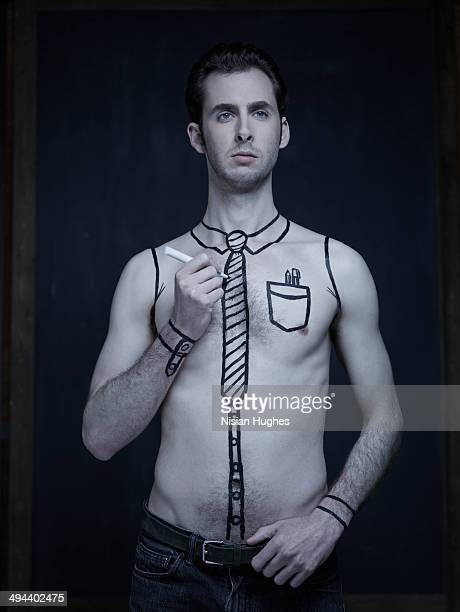 Man drawing clothing onto his skin