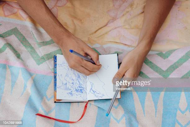 Man drawing in notebook