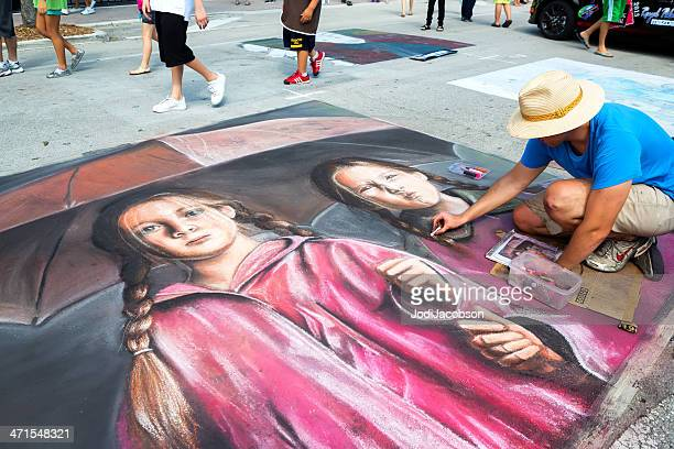 man drawing street art portrait. - chalk art equipment stock pictures, royalty-free photos & images