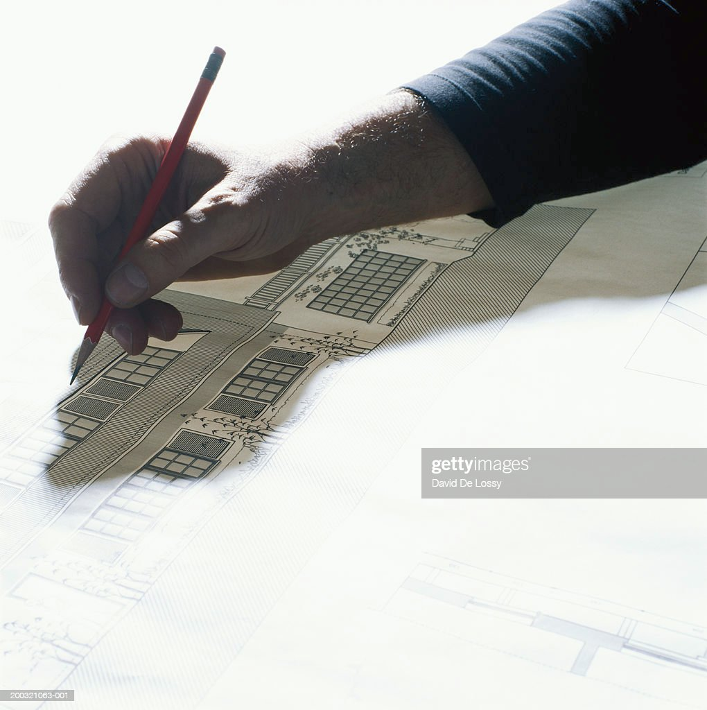 Man drawing with pencil, elevated view : Stock Photo