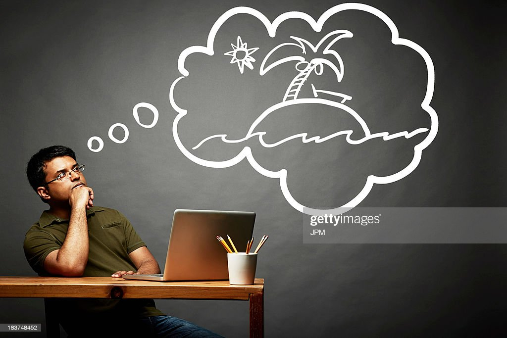 Man dreaming of island in the sun : Stock Photo