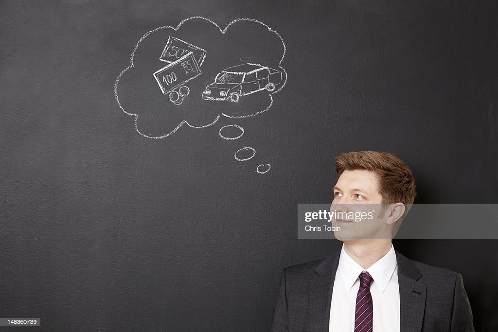 Man dreaming of money and cars : Stock Photo