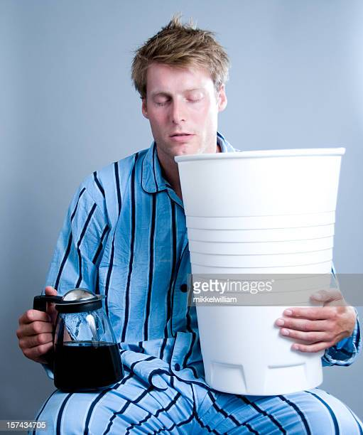 Man dreams about coffee and holds a gigant cup