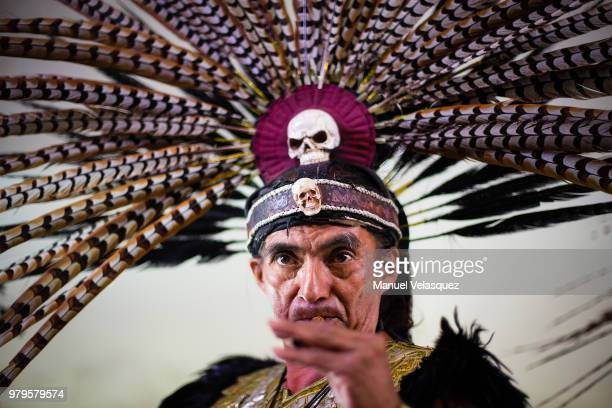 A man dress as indigenous mexican plays the flute during a meeting with indigenous groups at Fuego Nuevo Archaelogical Museum on June 18 2018 in...