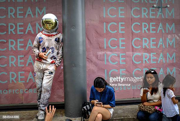 A man dress up as astronaut stands outside the new Museum of Ice Cream across from the Whitney Museum on July 29 2016 in New York City The temporary...