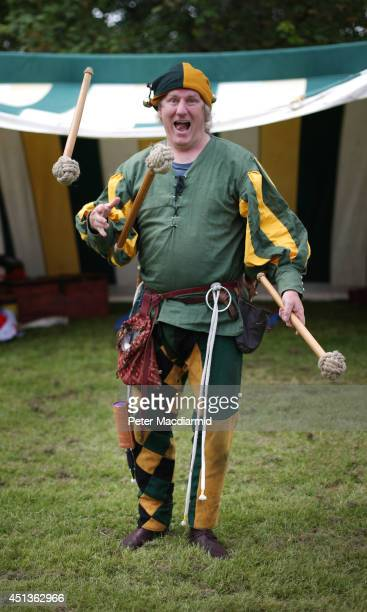 A man dressd as an 8th century jester performs at the Bannockburn Live event on June 28 2014 in Stirling Scotland The 700th anniversary of the...
