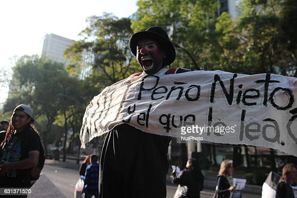 A man dressed a a clown protest against fuel prices in Mexico City on 9 January 2017 Largely peaceful protests against the fuel price increases...