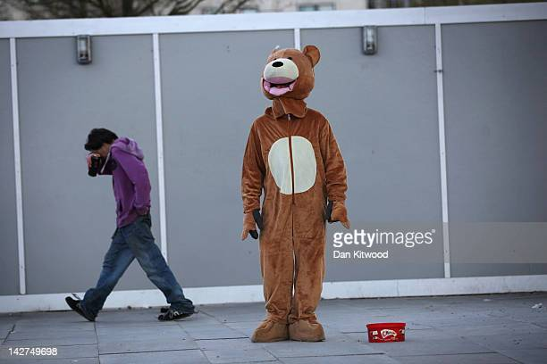 A man dressed as a bear stands on the South Bank on April 11 2012 in London England The South Bank which runs alongside the River Thames is one of...