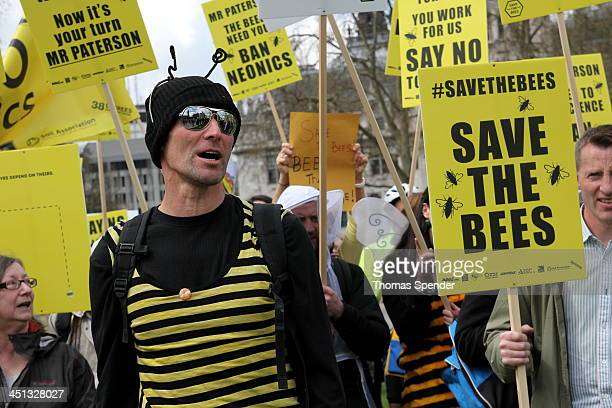 CONTENT] A man dressed as a bee protests outside the Houses of Parliament against the use of neonicotinoid fertilisers which beekeepers say disorient...