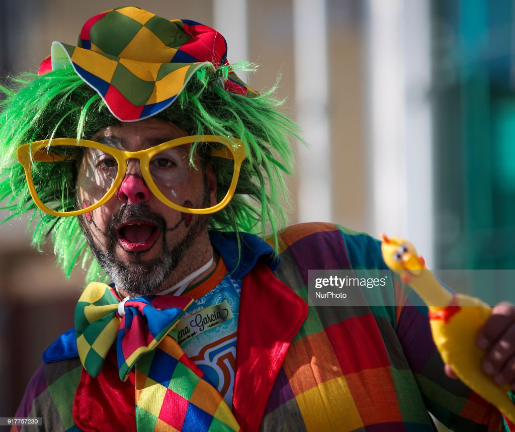 A man dressed as a clown pose for the photo during the Carnival Clown's Parade at Sesimbra village on February 12, 2018.