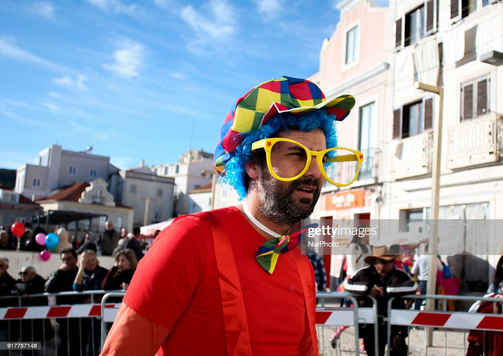 A man dressed as a clown takes part on the Carnival Clown's Parade at Sesimbra village on February 12, 2018.